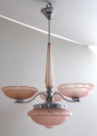 White metal chandelier with pink shades