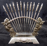 Silver stand and twelve silver skewers, Chinese style